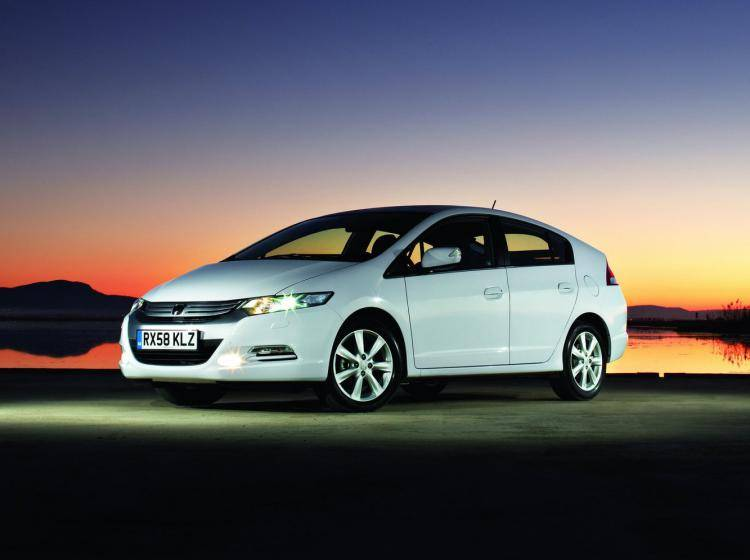 Фото Honda Insight II - схожий с Volkswagen Golf VI
